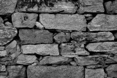 Natur-Steinmauer grau