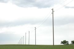 Strommasten auf Feld
